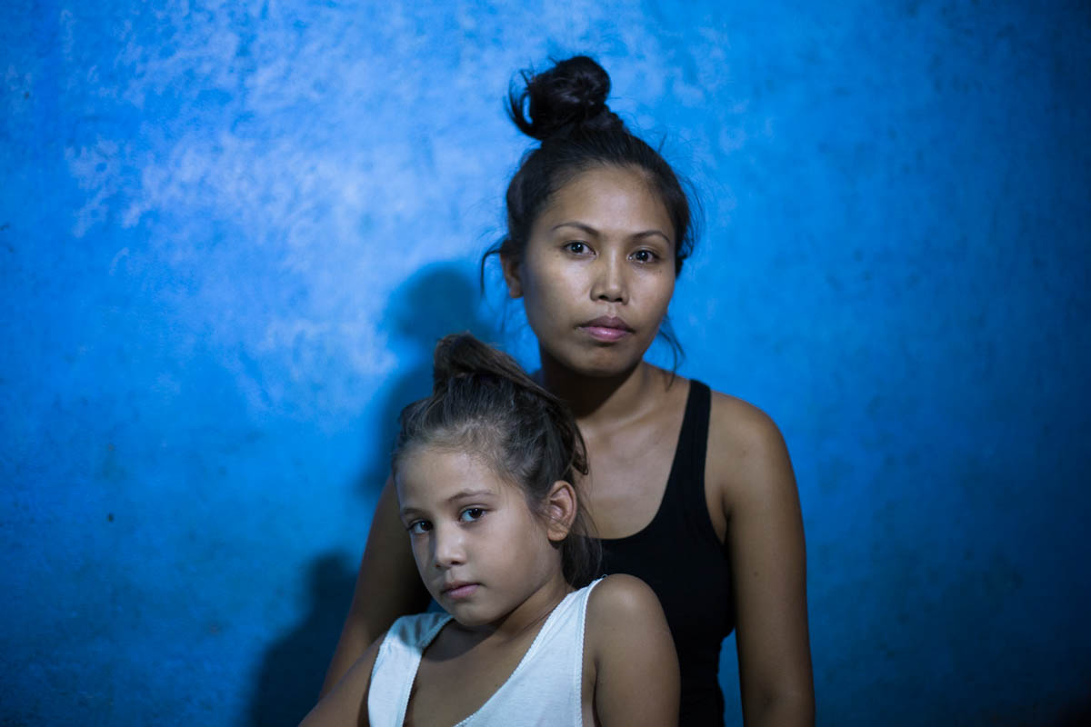 "Nathalie and Blessimai - Nathalie, 32, and Blessimai, 9, in their house in Mabalacat. Nathalie works in Fields Avenue to give a better future to her seven children.  Mabalacat near Angeles City, Philippines, May 2015. - Copyright © © S. Borcard - N. Metraux - Mabalacat City - Central Luzon - Philippines - <A href=""https://maps.google.com/?ll=15.229155,120.604955&z=16"" target=""_blank"">(Map Nathalie and Blessimai)</A>"