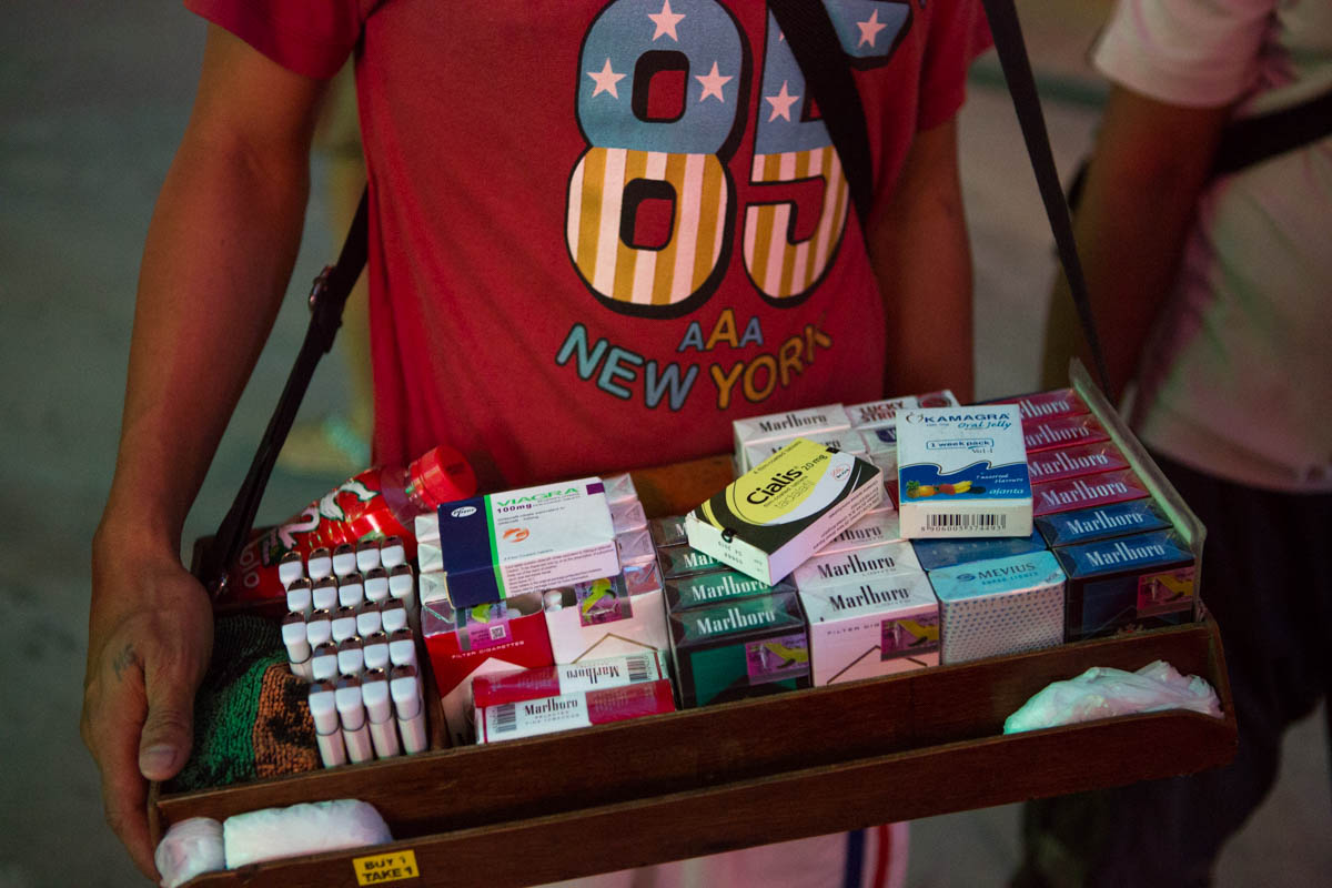 "Viagra on display - Street vendor on Fields Avenue. Besides selling cigarettes and lighters, he also sells Viagra and Cialis for 500 pesos (10 €) a box.  Angeles City, Philippines, May 2015. - Copyright © © S. Borcard - N. Metraux - Angeles - Central Luzon - Philippines - <A href=""https://maps.google.com/?ll=15.167375,120.588597&z=16"" target=""_blank"">(Map Viagra on display)</A>"