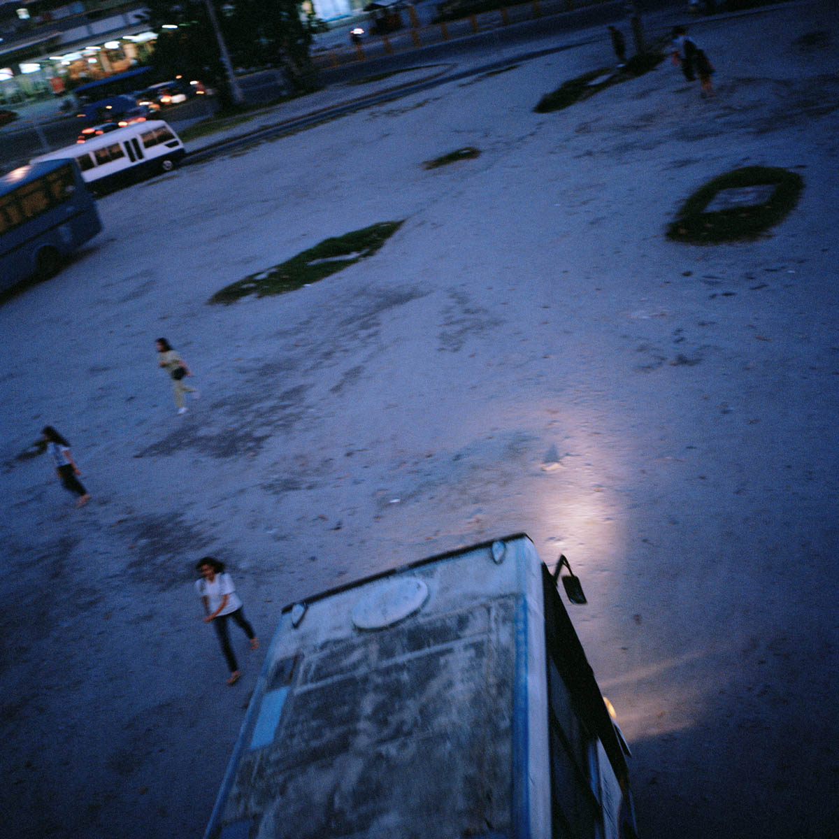 "Bus stand - The bus stand of Balibago at dusk. Angeles City, Philippines, August 2014. - Copyright © © S. Borcard - N. Metraux - Angeles - Central Luzon - Philippines - <A href=""https://maps.google.com/?ll=15.168055,120.586388&z=16"" target=""_blank"">(Map Bus stand)</A>"