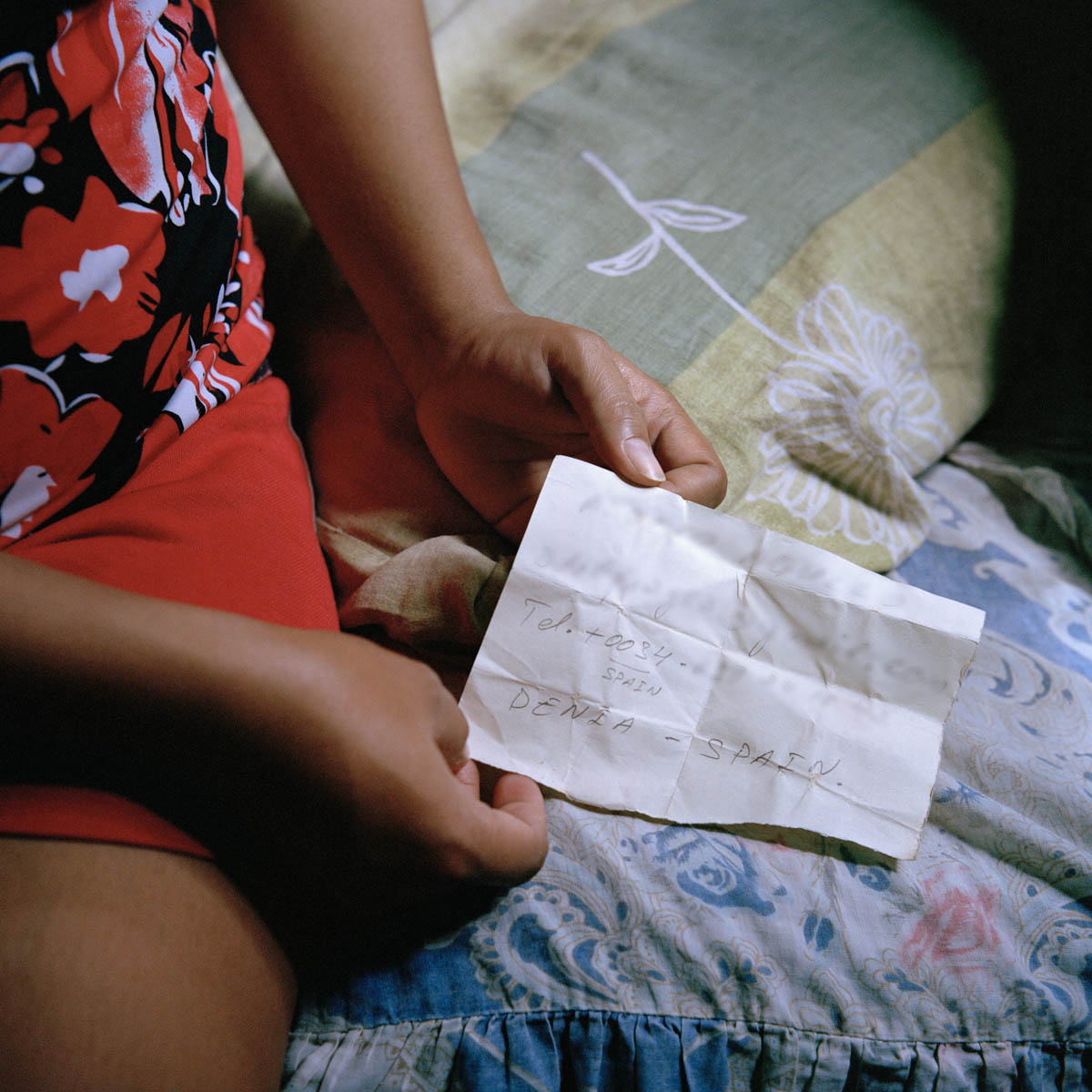 """Address - Antonia, 26, holds the address of her daughter's father. He is around 60 years old, comes from Spain and spent one week in Angeles City as a """"tourist"""". He does not know about his fatherhood. Angeles City, Philippines, August 2014. - Copyright © © S. Borcard - N. Metraux - Angeles - Central Luzon - Philippines - <A href=""""https://maps.google.com/?ll=15.168055,120.586388&z=16"""" target=""""_blank"""">(Map Address)</A>"""