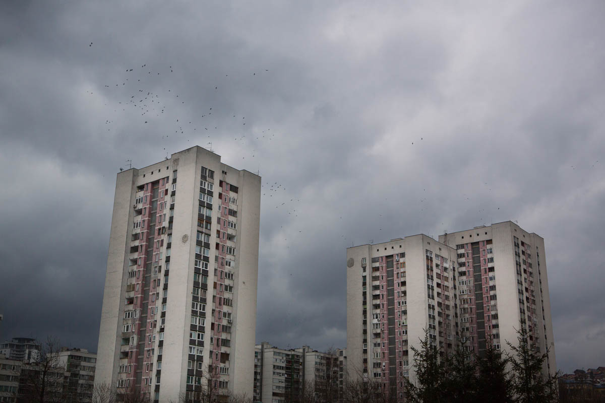 Grey Skies Black Birds - Dark clouds above. A flock of birds fly overhead.  Sarajevo, March 2015 - Copyright © © S. Borcard - N. Metraux -