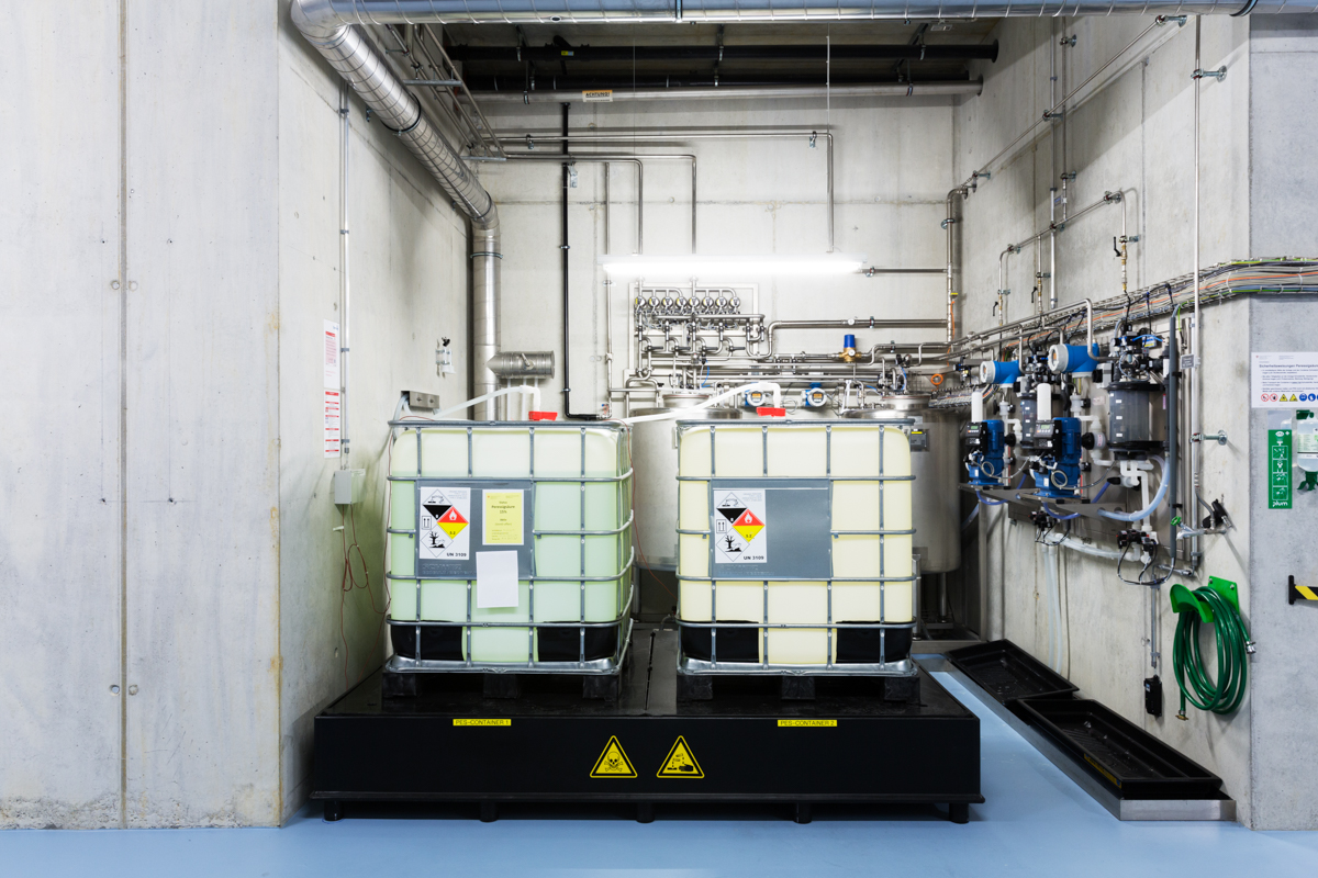 Huge tanks of disinfectant and acid used to neutralise infectious pathogens in the basement of the biohazard facility. Spiez Laboratory, Spiez, June 2017