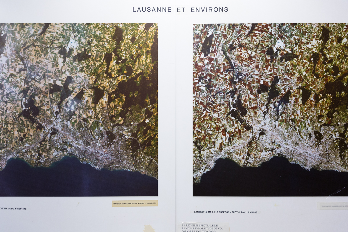 A giant display board showing a satellite view of Lausanne and nearby Lake Geneva decorates the hallway near Prof. Tamar Kohn's office. EPFL, Lausanne, June 2017