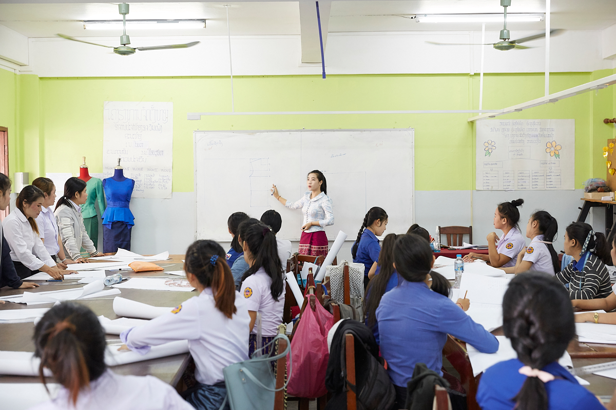 Class at the Vientiane Capital Skill Development Center. Young Lao women are here given a chance to learn the basic skills of industrial sewing. Vientiane, Laos, November 2018.