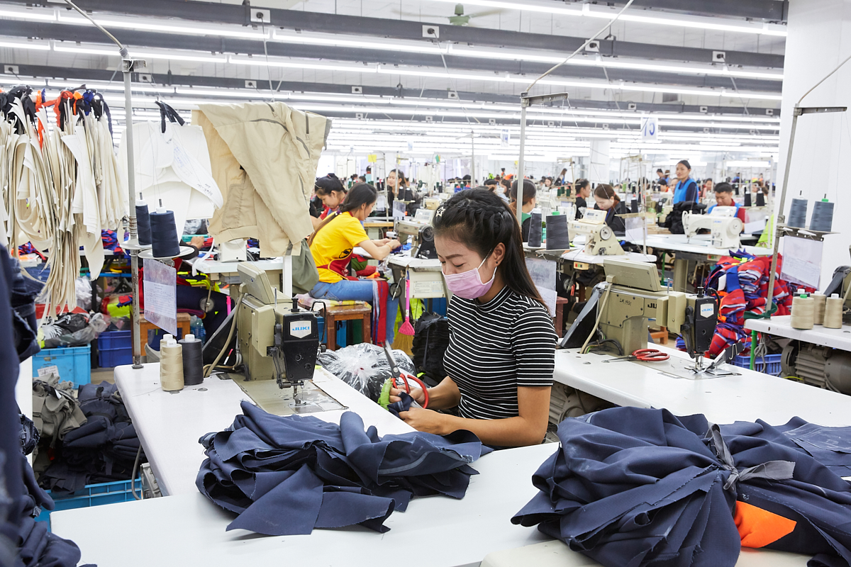 A worker at Trio (Lao) Export Co. Ltd., Lao's largest garment factory. Laborers work eight hours a day and earn 250 USD per month. Vientiane, Laos, November 2018.