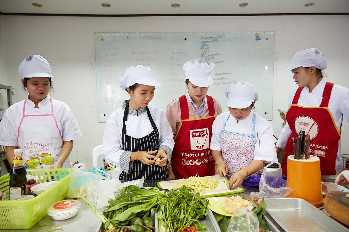 Young women chopping ginger at the Vientiane Capital Skill Development Center. Here these young people get a chance for education and training various professions. Vientiane, Laos, November 2018.