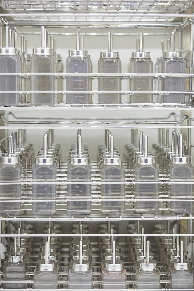 Water bottles carefully sterilized and stacked in trays. Vetsuisse Faculty, University of Zürich, October 2018.
